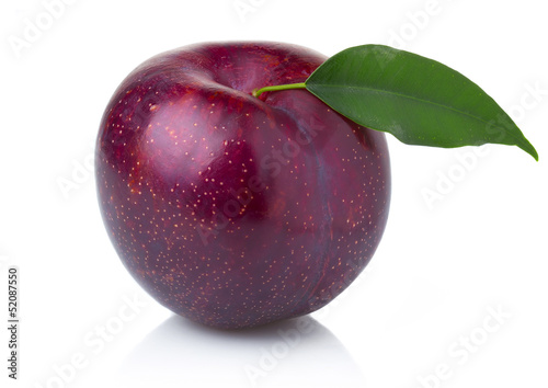 Ripe purple plum fruit with green leaves isolated