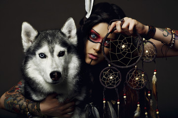 American Indian girl with dog