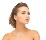 woman wearing shiny diamond necklace
