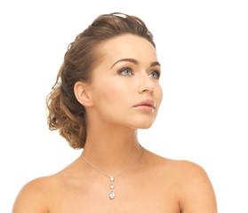 woman wearing shiny diamond necklace