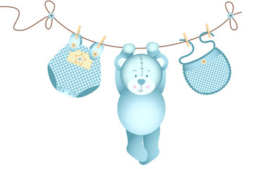 Teddy bear baby boy hanging on a clothesline