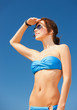 woman in bikini and sunglasses