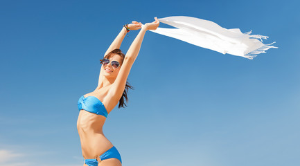 woman in bikini and sunglasses