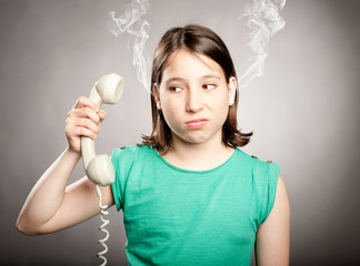 young girl with telephone overwhelmed