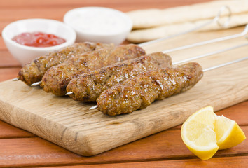 Seekh Kebabs - Minced meat kebabs on metal skewers