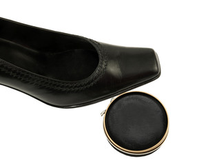 black female leather shoes with shoe polish