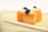 Tasty rolls with salmon, cream cheese and caviar