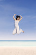 Beautiful woman jump at beach