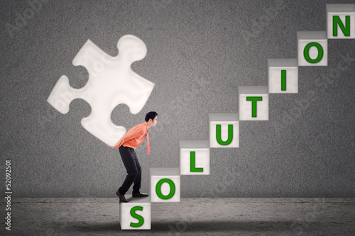 Businessman bring puzzle of solution