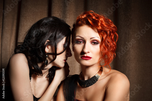 Two attractive women in hotel