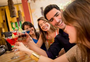 Happy friends having drinks