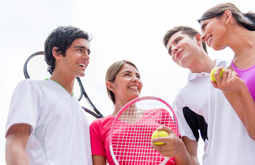 Group of tennis players talking