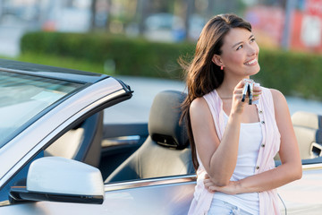 Happy woman holding car keys