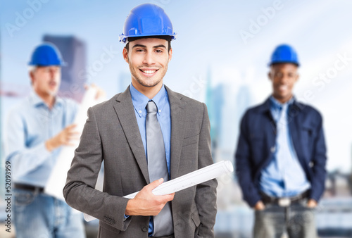 Smiling architect in front of his team