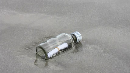 message in glass bottle on the beach