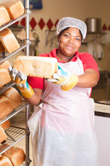 Woman with hot and fresh baked bread.