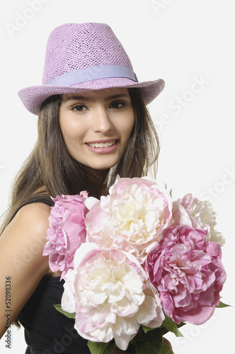 Beautiful Girl in hat with bouquet of flowers