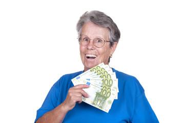 Femme âgée avec une liasse de billets.