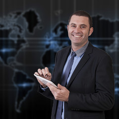 smiling business man with tablet pad networking