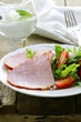 Baked sliced ham served with green salad