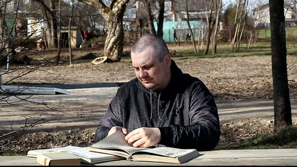 Man reading a book at the table