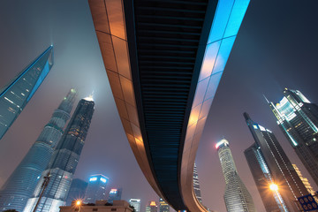 pedestrian bridge with shanghai skyline at night