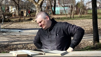 Man stretches after reading books