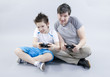 Boy and man playing in videogame