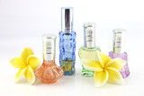 The yellow flowers and Orange,Blue,Green,Violet Perfume bottles.