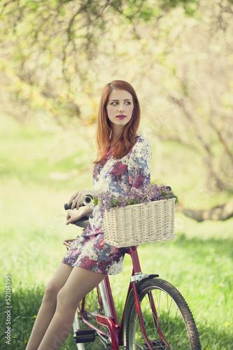 Fototapeta Girl on a bike in the countryside