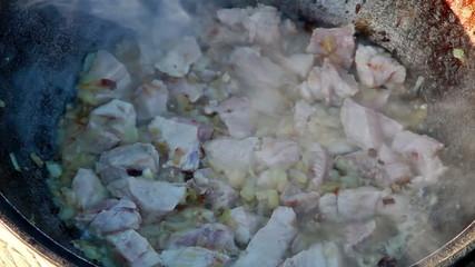 Cooking pilaf. Stewed meat