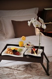 Fototapety Breakfast in bed at a luxury hotel room