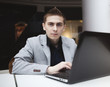 young man working with laptop. work, business