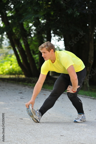 Young athlete stretching in the park