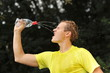 Young man athlete refresh himself and drinking water