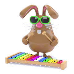 Chocolate bunny plays xylophone