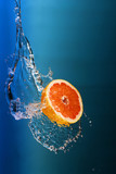 fresh lemons under water jet splash