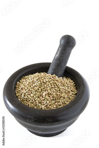 Buckwheat in mortar on white background