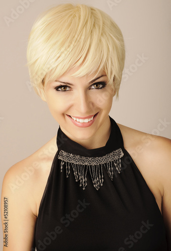 Pretty girl with short light blond hair