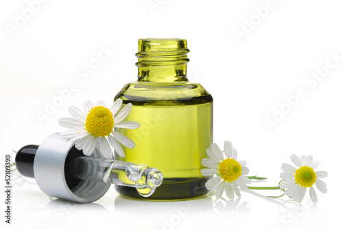 Cosmetic oil with daisy flower