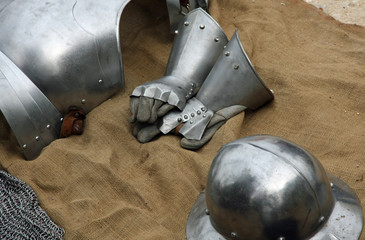 gloves and metal armor with a helmet during the medieval spectac