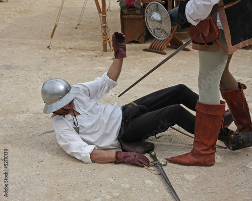 ancient medieval costume with soldier mortally wounded while sim