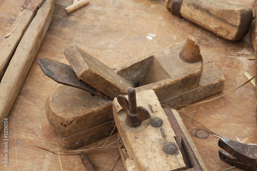 old wooden and iron Planer for the manufacture of wooden planks