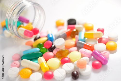 Pills and capsules on white