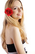 Beautiful young woman with red rose in her hair
