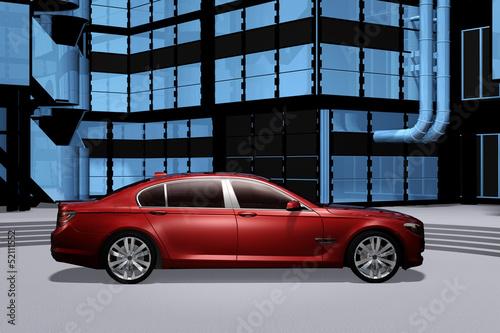 Rote Limousine vor moderner Bürogebäudefassade