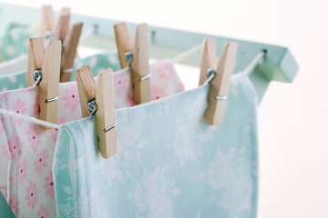 Laundry drying with wooden clothespins