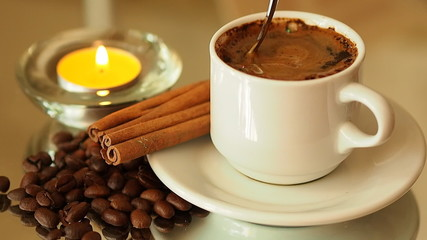candle with a cup of coffee. Spoon coffee mixes