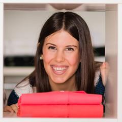 young woman looking through shelf