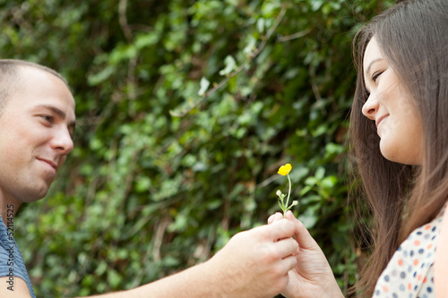 Guy Giving His Girl a Flower